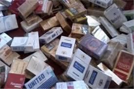 مصادرة 100 الف عبوة سجائر مهربة جمركيا ومجهولة المصدر داخل مخزنين بالحدائق وعين شمس
