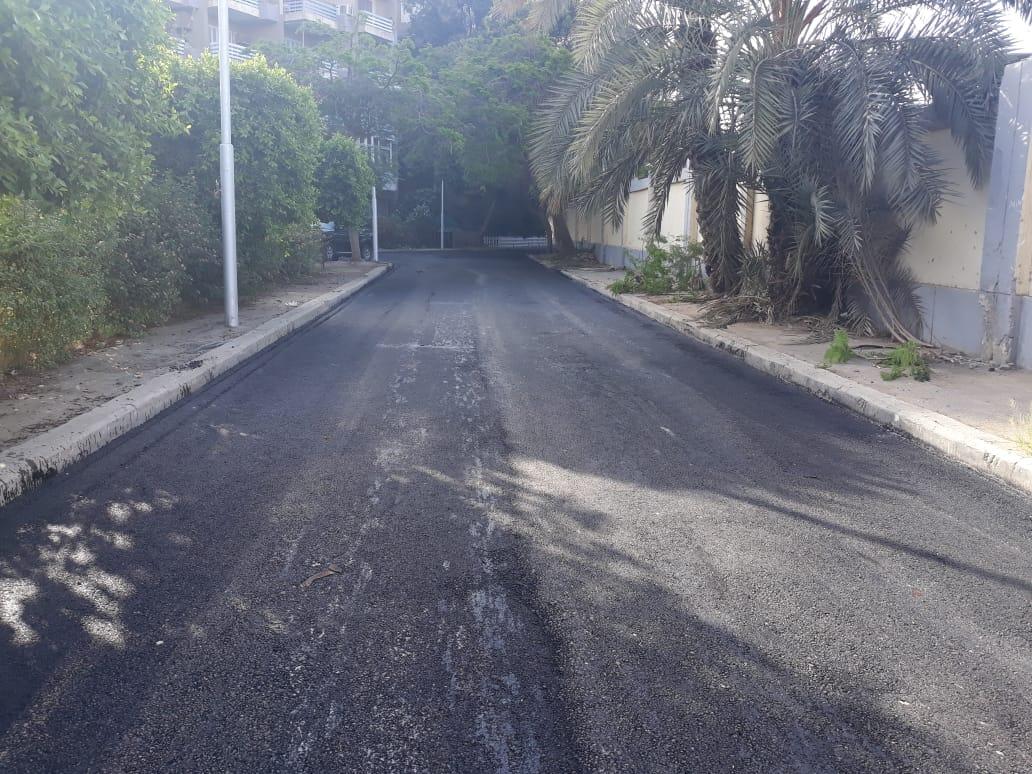 رصف وترميم عدة شوارع بنطاق حى المعادى