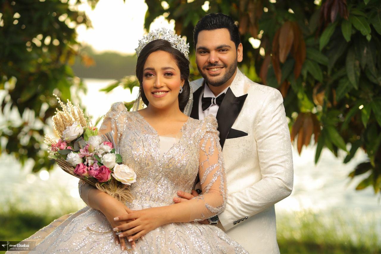 أسامة عونى وآلاء محمد زكريا فى قفص الزوجية